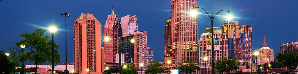 Illuminated Midtown in Atlanta, USA at night. Car traffic, illuminated buildings and dark sky